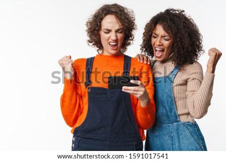 Filles amis denim téléphone portable image belle Photo stock © deandrobot