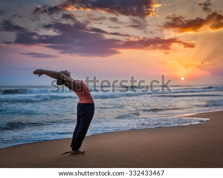 Young sporty fit woman doing yoga Sun salutation Surya Namaskar Stock photo © dmitry_rukhlenko