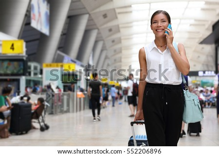 Businesswoman on commute transit talking on the smartphone while walking with hand luggage in train  Stock photo © Maridav