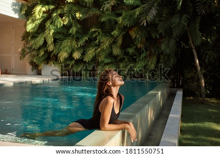 young beautiful woman in swimsuit on tropical beach, summer vacation, palm tree leaf, tanned skin, s Stock photo © galitskaya