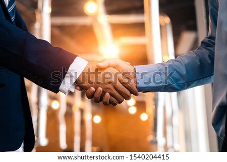 Shaking hands after good cooperation, Businessman handshake male Stock photo © Freedomz