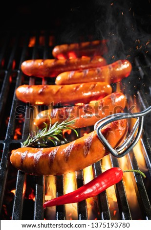 Grilled sausages, meat, and vegetables. Stock photo © furmanphoto