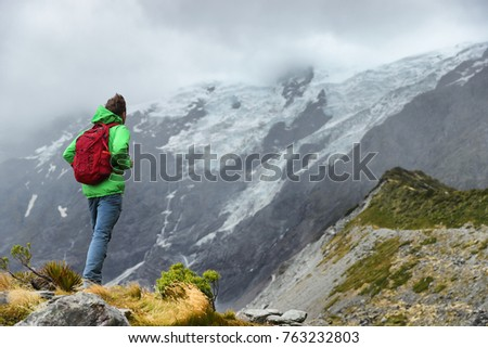 New Zealand hiker man hiking, enjoying view of snow capped mountain landscape in Hooker Valley track Stock photo © Maridav