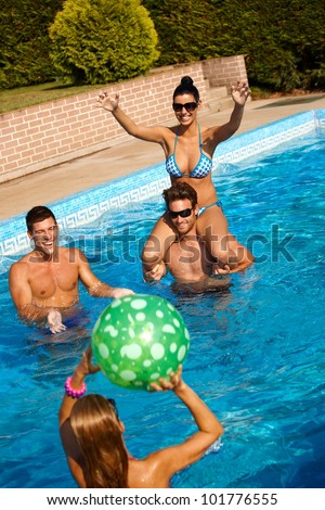 Young woman plays in the pool with a beach ball Stock photo © galitskaya