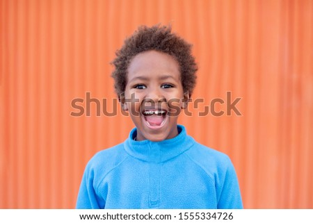 Funny african child with blue jersey  Stock photo © Gelpi