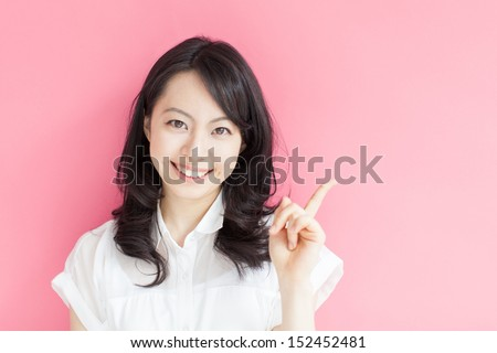 Beautiful woman pointing at a copy space against a white background stock photo © wavebreak_media