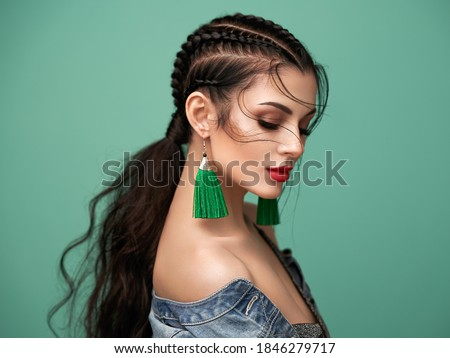 Portrait of young woman with braid hairdo stock photo © zastavkin