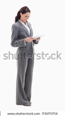 Businesswoman smiling watching a touch pad against white background stock photo © wavebreak_media