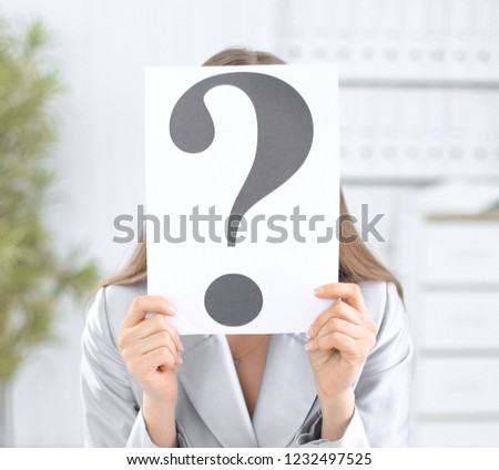 portrait of business woman with question mark on placard over gr stock photo © hasloo