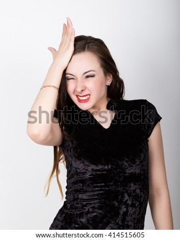Woman slaps his forehead in an oh-no moment, disappointed, isola Stock photo © dacasdo