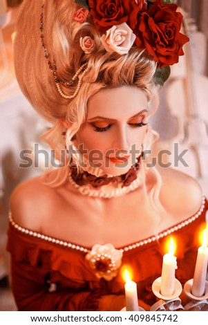 attractive young woman in victorian style costume and rose corse stock photo © elisanth