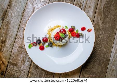 Panna cotta with Raspberry Sauce, Italian dessert on wood backgr Stock photo © Yatsenko