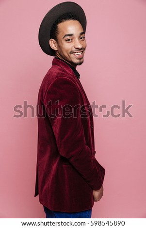 Stylish afro american man in hat and lacket looking at camera Stock photo © deandrobot