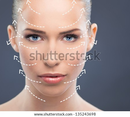 The beautiful woman face  with arrows close up over blue background Stock photo © master1305