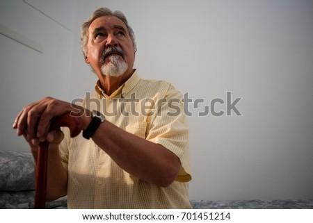 Figyelmes szomorú idős férfi tart sétál Stock fotó © wavebreak_media
