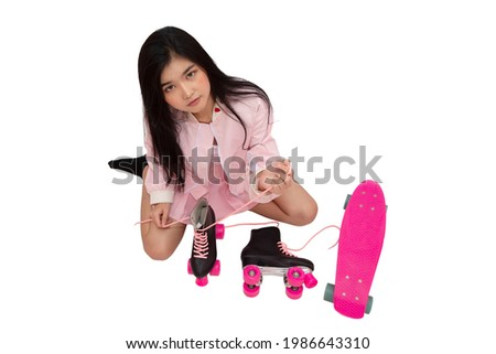 Young lady sitting on skateboard and tie shoelaces isolated Stock photo © deandrobot