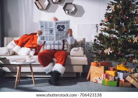 Santa Claus reading business news Stock photo © stokkete