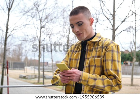 Androgynous man talking on his mobile phone Stock photo © wavebreak_media