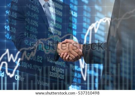 shaking hand between businessman of cooperation over stock marke stock photo © snowing