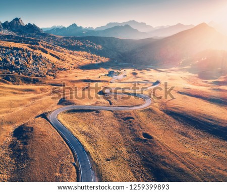 aerial view of the road in mountain valley at sunset in summer stock photo © denbelitsky