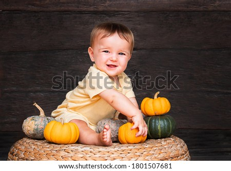 happy little girl with autumn pumpkin by the wooden wall backgro stock photo © dashapetrenko