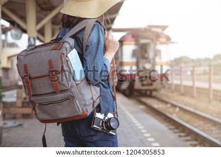 young man traveler with backpack are holding map relaxing outdo stock photo © freedomz