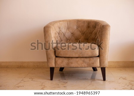 beige leather sofa and soft velvet armchairs standing by wooden table in cafe stock photo © pressmaster