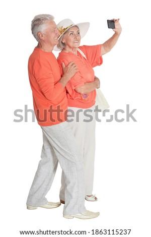 Vue arrière couple de personnes âgées téléphone portable plage soleil Photo stock © wavebreak_media