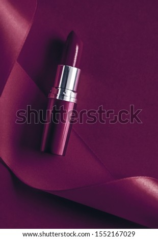 Luxury lipstick and silk ribbon on plum holiday background, make Stock photo © Anneleven