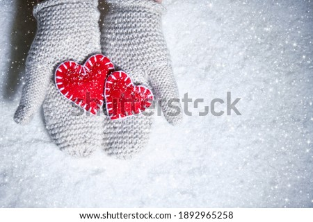 Woman Wearing Red Mittens Holding Christmas Gift Against Decorat Stock photo © feverpitch
