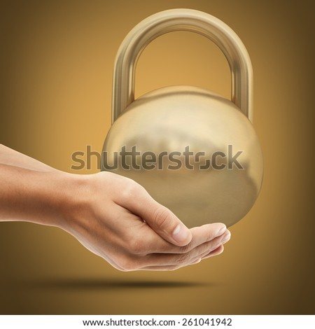 A hand holding heavy weight of gold Stock photo © nomadsoul1