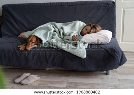 Young restful female lying on couch and waiting for uploading of yoga website Stock photo © pressmaster