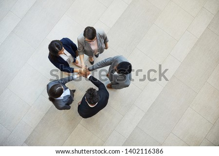 High angle view of young multi-ethnic business executive working together on the sofa in modern offi Stock photo © wavebreak_media