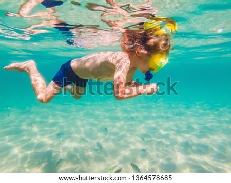 Underwater nature study, boy snorkeling in clear blue sea BANNER, LONG FORMAT Stock photo © galitskaya