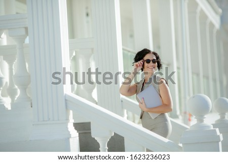 An adult woman climbs the white pillared steps to the business center Stock photo © ElenaBatkova