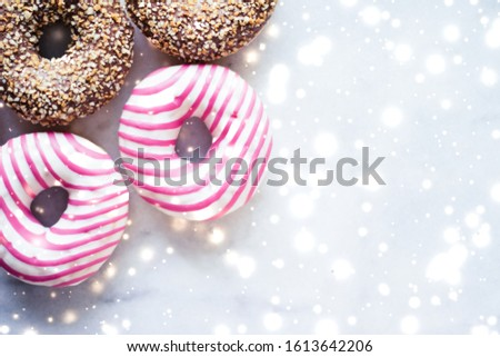 Colourful donuts on marble table with glowing snow, winter holid Stock photo © Anneleven