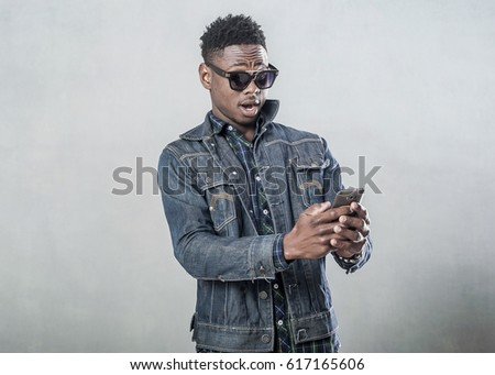 Image of young african american guy smiling and talking on cellp Stock photo © deandrobot