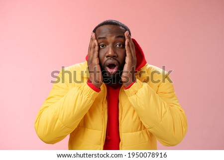 Shocked gasping and impressed handsome guy standing speechless as watching friends home party video  Stock photo © benzoix