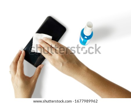 Hand with Isopropyl alcohol for wipe or cleaning mobile phone to Stock photo © snowing