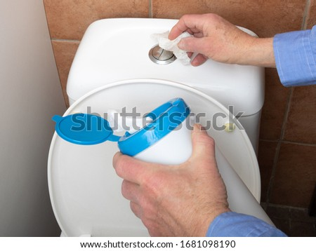 Surface sanitizing wipes of bathroom surfaces, toilet flush wall button wiping paper towel sanitizer Stock photo © Maridav