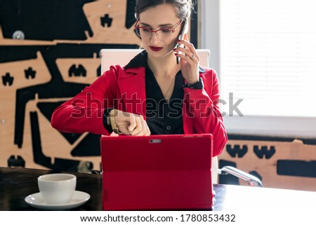Businesswoman needs to go because she is late but the call goes on Stock photo © Kzenon