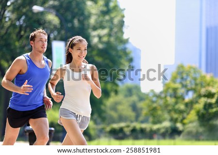 Girl jogging in park living an active summer. Runner woman running on sidewalk, healthy lifestyle Stock photo © Maridav