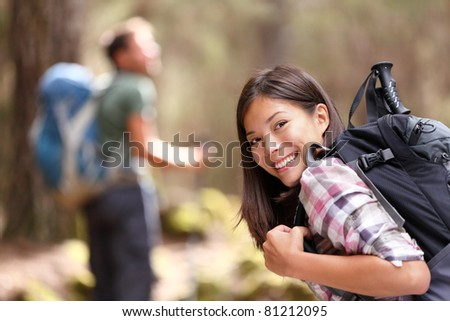 Happy backpacker girl hiking in autumn forest. Young asian hiker woman in outdoor gear for cold weat Stock photo © Maridav