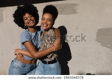portrait of two young twins women standing against each other c stock photo © hasloo