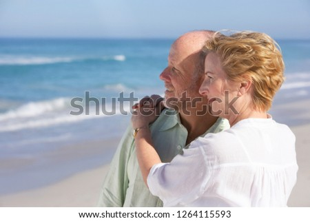 Senior woman looking out over a sandy beach on a summer day Stock photo © photography33
