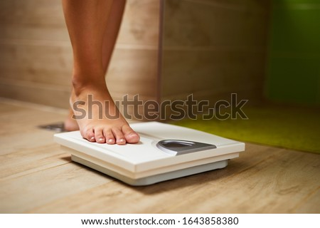 woman weighing herself Stock photo © photography33