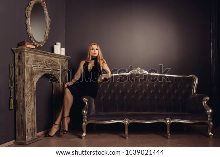 Beautiful woman with book sitting on the sofa in antique interio Stock photo © Pilgrimego