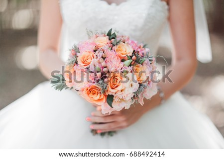 bride holding bunch of flowers at wedding stock photo © travelphotography