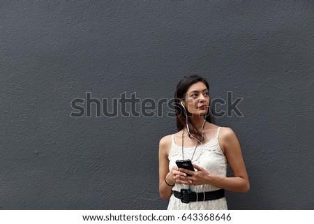Beautiful businesswoman looking up while phoning against white background Stock photo © wavebreak_media