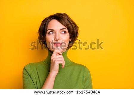 Young woman thinking with hand on chin Stock photo © bmonteny